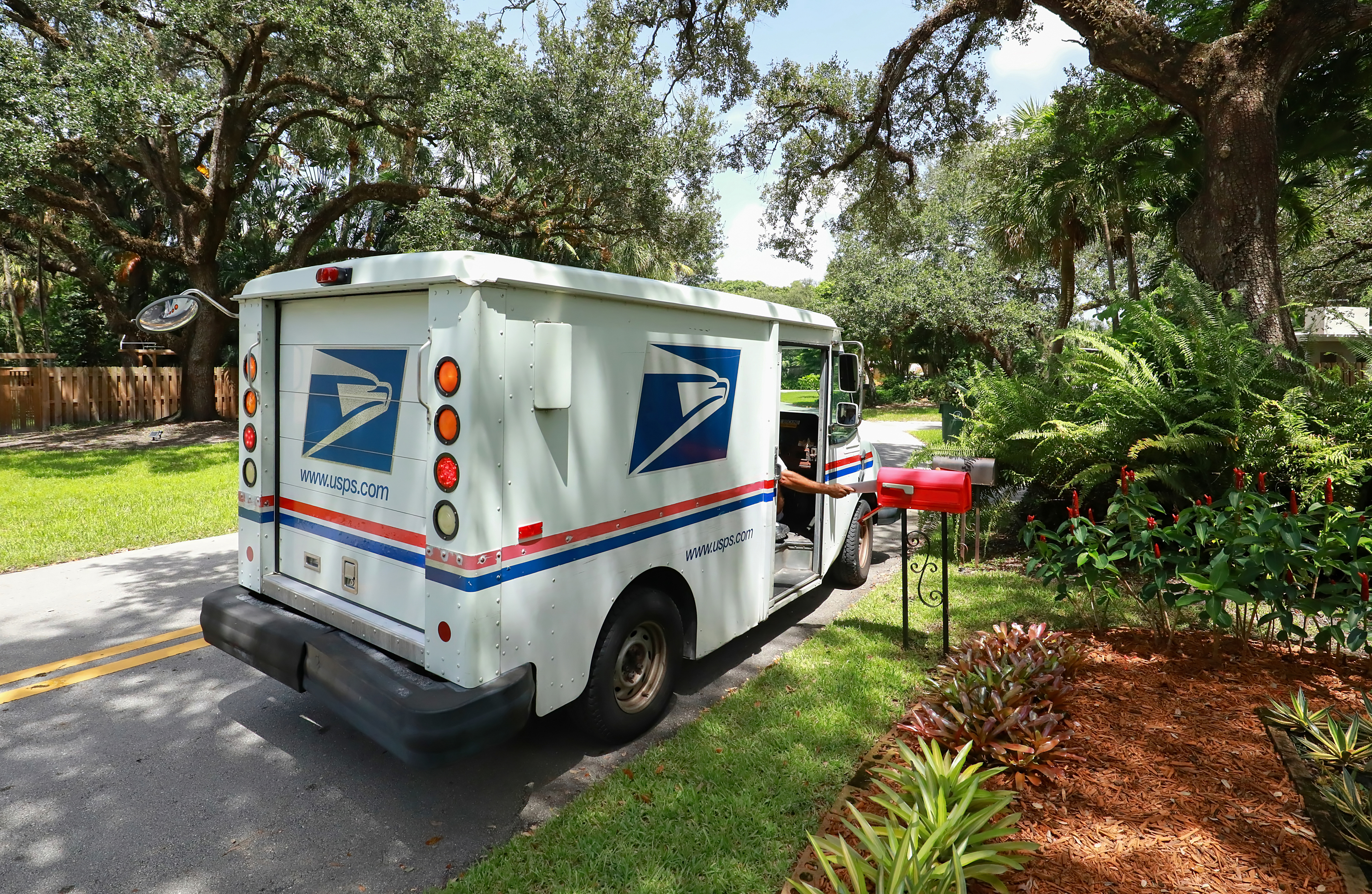 Mail truck at mail box