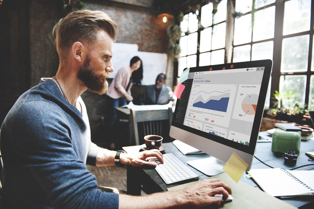 Man-at-desktop-checking-marketing-metrics